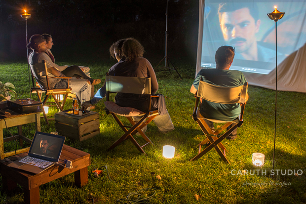 movie night with near by tables for drinks and snacks