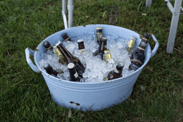 antique metal bucket filled with ice and beverages