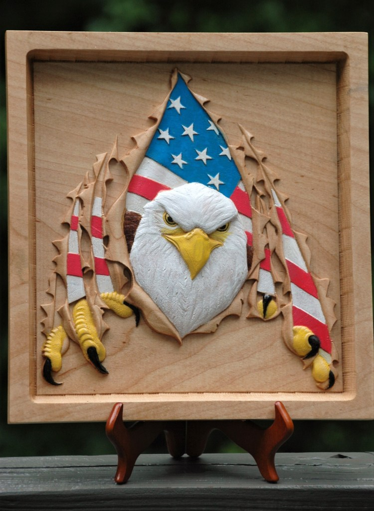 United States bald eagle tearing through plaque