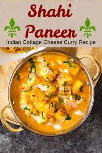 Shahi Paneer seved in a bowl with saffron and coriander as garnish.