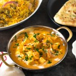Restaurant style Shahi paneer served alongside biryani and naan.