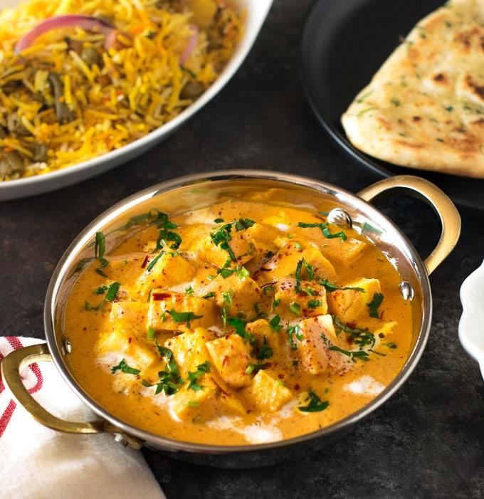 Shahi Paneer served with biryni and naan