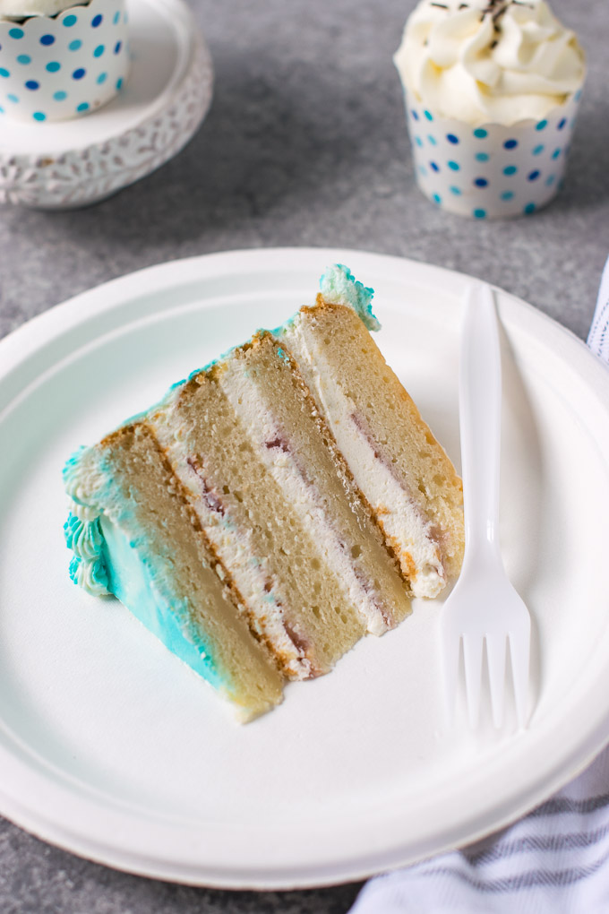 4 layer cake on a white plate
