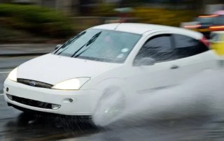splashing car in the rain