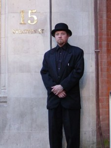 Playing a gig in London England sport a Steed bowler hat