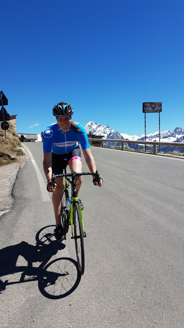 Sophie, reaching Passo Sella on a fine afternoon with Marmolada in the background.