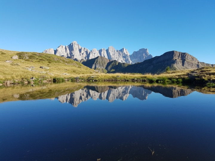Looking across a high mountain tarn opposite the Pale di San Martino