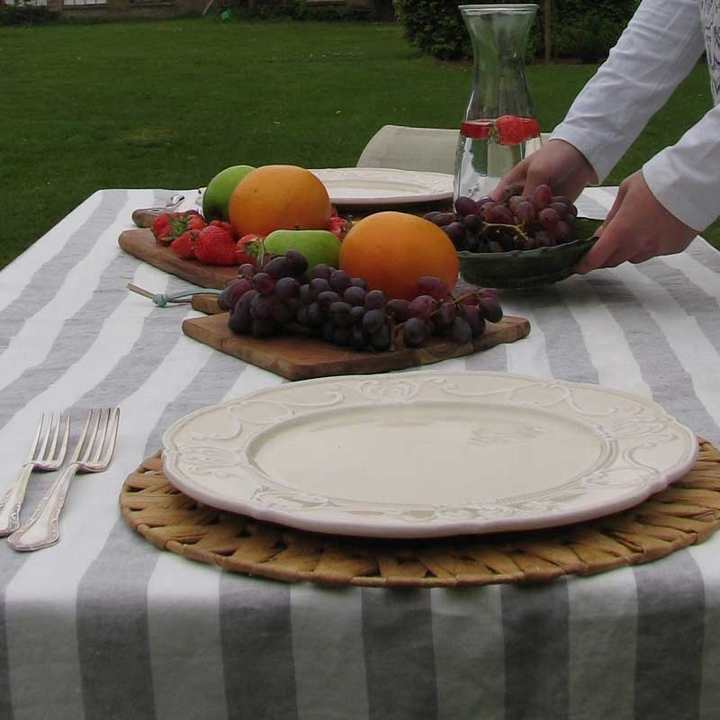 Linen tablecloth with light gray and white wide stripes. Brand Casa Homefashion, available online at Casa Comodo