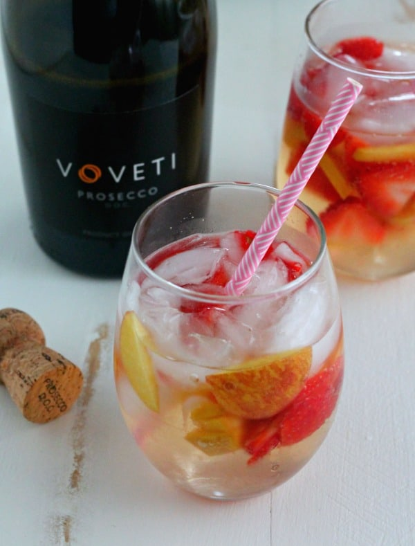 Peach and Strawberry Sparkling Sangria - the perfect cocktail for your spring, and summer soirees! | casadecrews.com