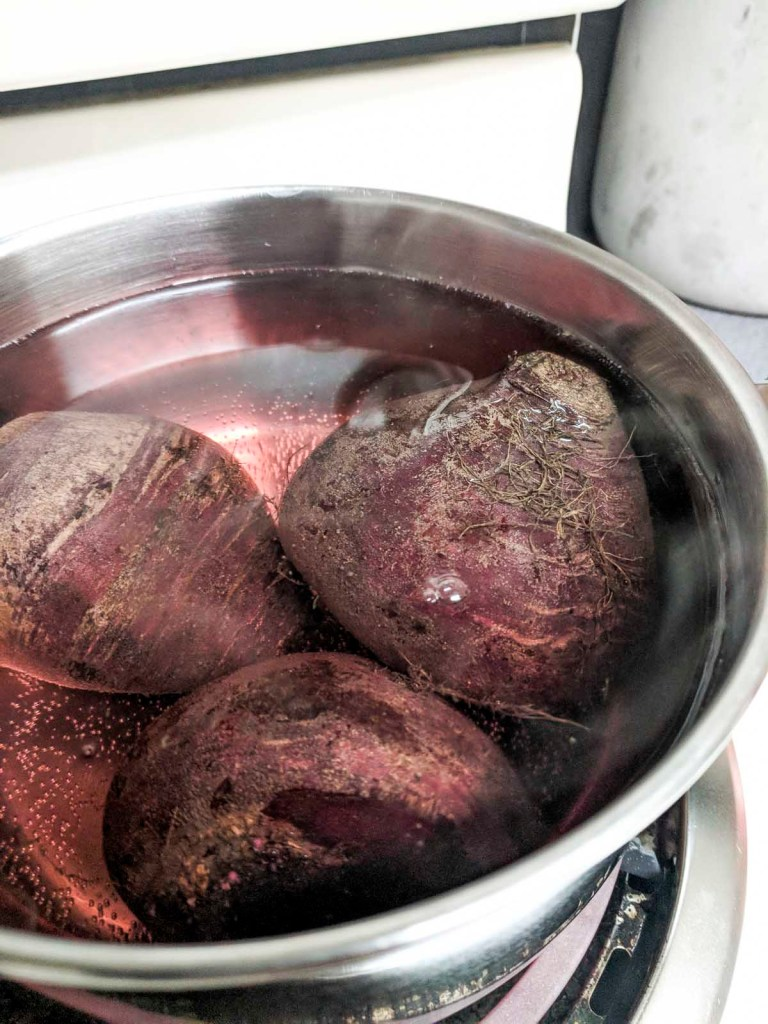 Beets boiling in a pot