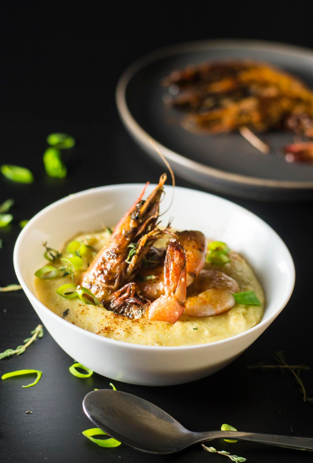 Shrimp and grits in a bowl on table