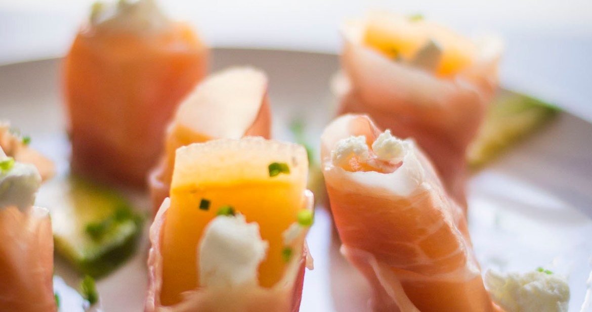 Close up Melon wrapped Prosciutto hors d'oeuvres