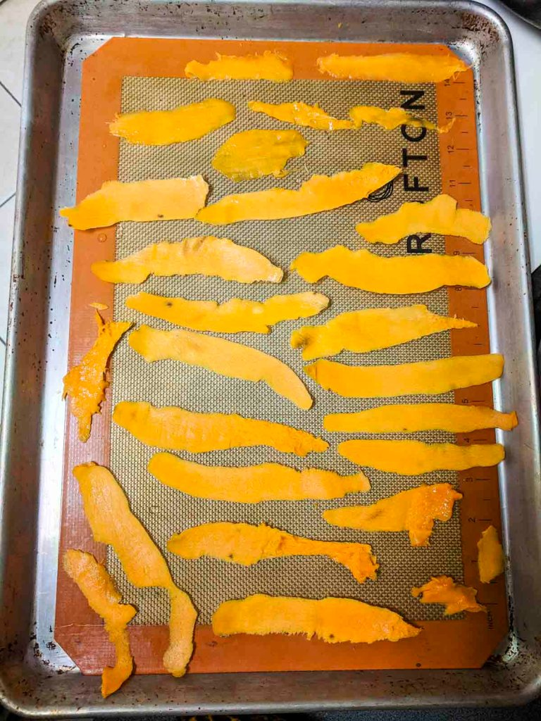 overhead shot of mango peel on silpat before going in oven