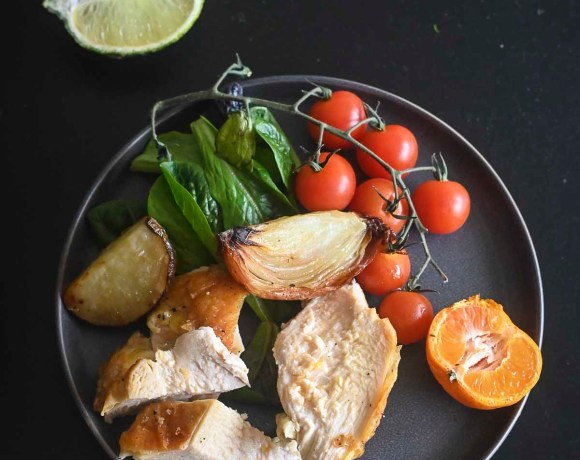 Roast Chicken on plate with tomatoes and vegetables