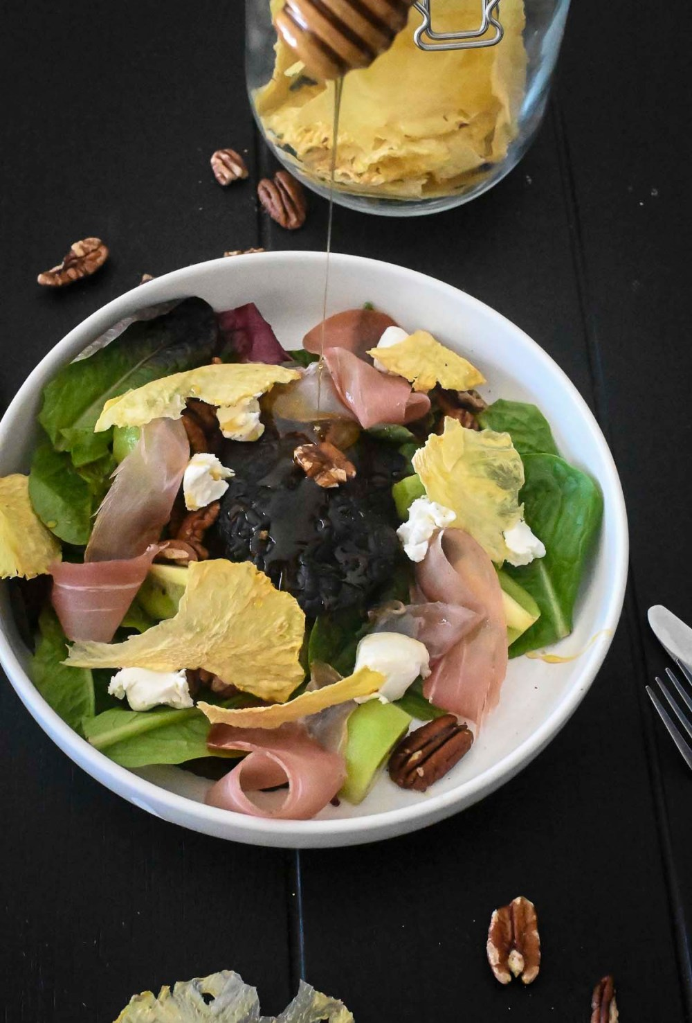 prosciutto and pineapple salad on table