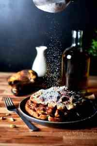 Banana Bread Waffles with sprinkled powdered sugar