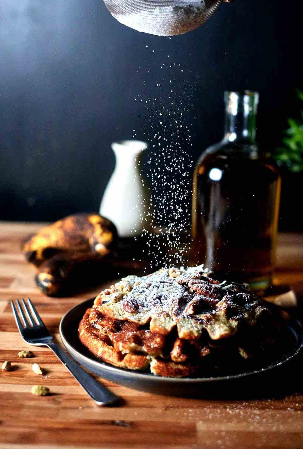 Banana Bread Waffles with sprinkled powdered sugar