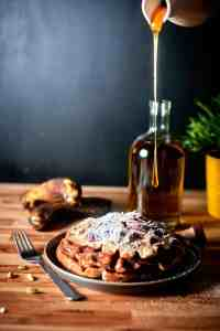 banana bread waffles on plate with honey poured