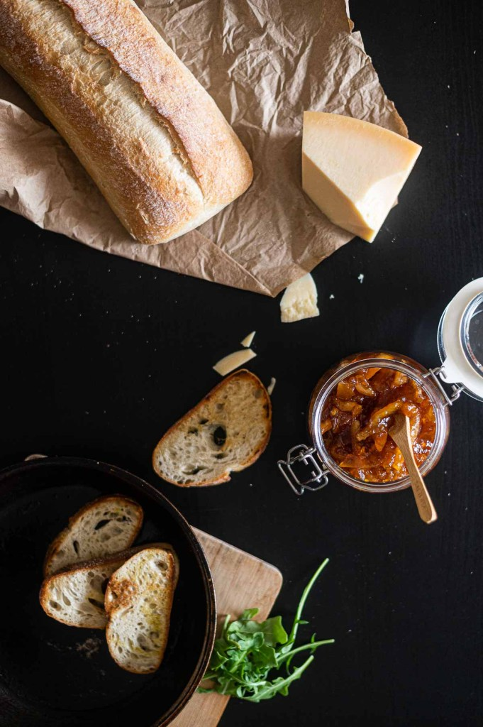 Old fashioned marmalade on table with cheese and bread