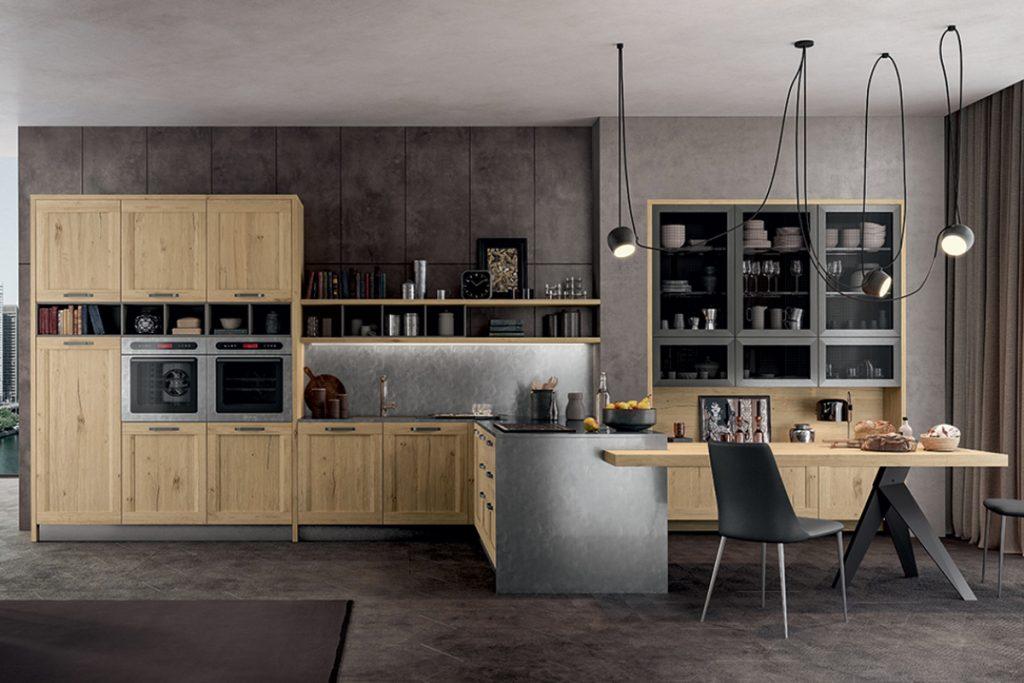 Cucina stile Industrial Chic con penisola e tavolo