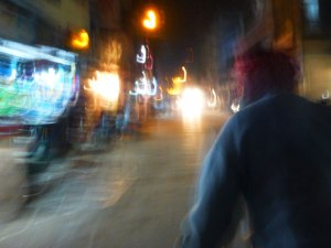 The chaos of a Varanasi evening as seen from the back of a bicycle rickshaw