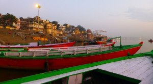 Colorful boats along the banks of the Ganges wait for the sunrise
