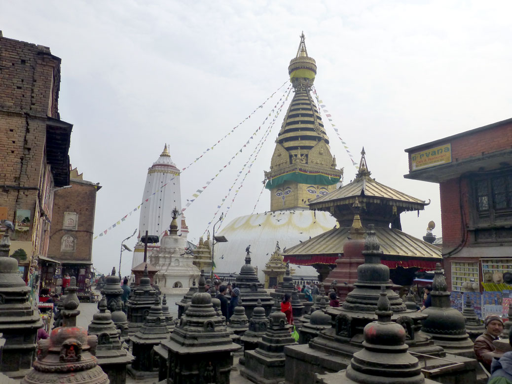 The stupa at Swayambhunath in February. The old shops and monastery residence building is still standing.