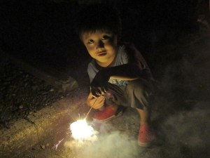 The little boy was probably four or five years old, but was lighting sparklers like a seasoned veteran.
