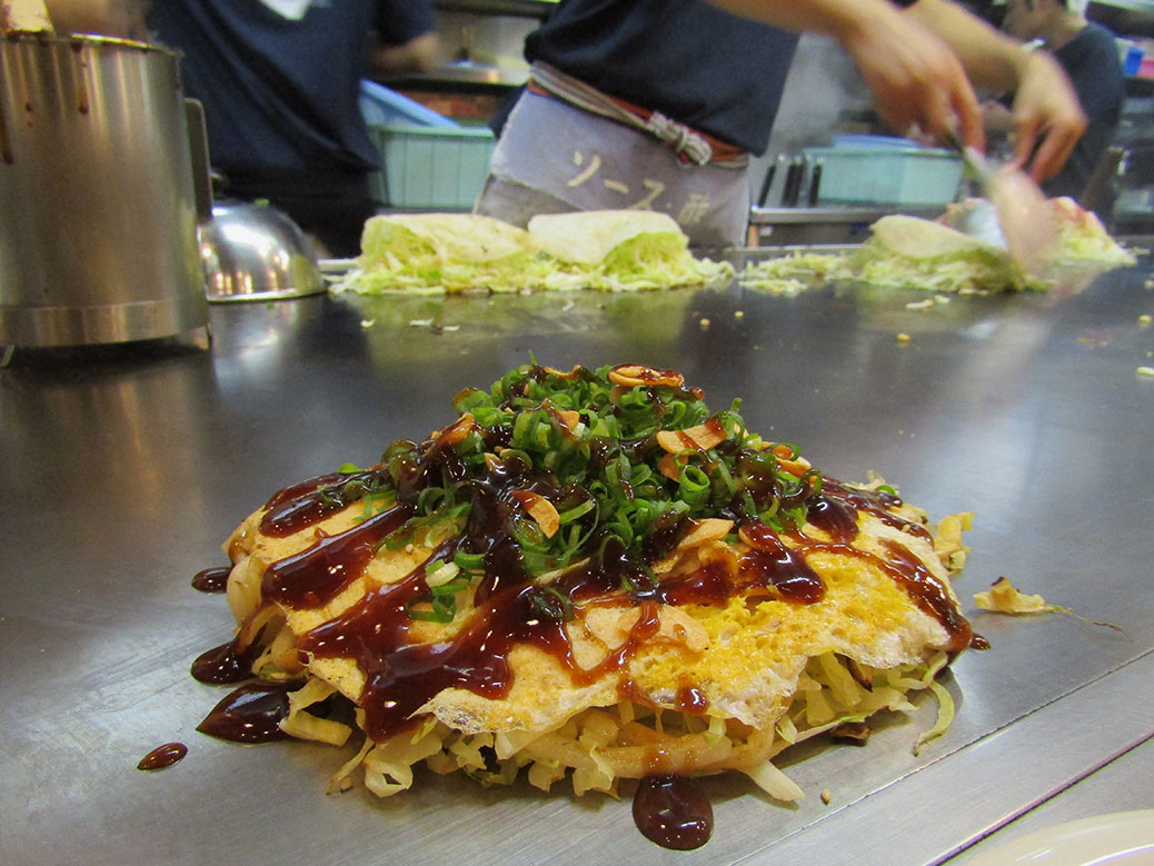 Vegetarian okonomiyaki at Nagata-ya in Hiroshima. Nagata-ya is one of the most popular shops in town and offers several vegetarian-friendly options—a rarity in Japan. The highlight was slivers of fried garlic sprinkled on top.