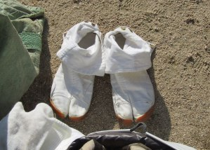A pair of shoes belonging to one of the monks who run barefoot through blazing fire and over hot coals