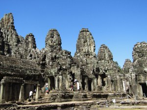 """Bayon temple stands at the exact center of the ancient capital of Angkor Thom. Around 200 faces of Lokesvara, the bodhisattva of compassion, are carved on Bayon's towers, giving it the nickname of """"The Temple of Smiling Gods."""""""