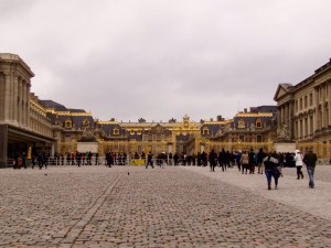 The gold-encrusted facade of The Palace of Versailles.