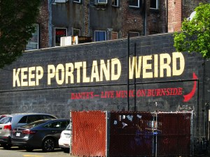 """The unofficial city motto, """"Keep Portland Weird,"""" painted on the back of Dante's on the edge of Old Town Chinatown."""