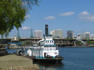 The Sternwheeler Portland docked along the Willamette River at the Oregon Maritime Museum. It is the last operating steam-powered sternwheel tug in the U.S.