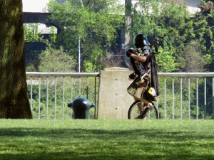 A Unipiper sighting! Unicyclist Brian Kidd is famous for rolling around town in a Darth Vader helmet playing occasionally-flaming bagpipes.