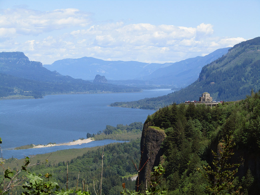 Looking east from the Portland Women's Forum State Scenic Viewpoint toward the Vista House on Crown Point and down the Columbia River Gorge.