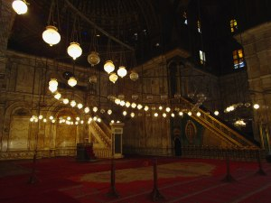 """The """"minbar"""" of the mosque (center left) is where the prayer leader sits and leads prayer and service."""