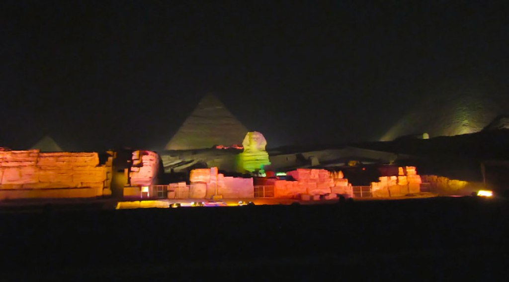 The Great Pyramid Complex illuminated by colored lights. If you have a tripod for your camera, bring it with you.