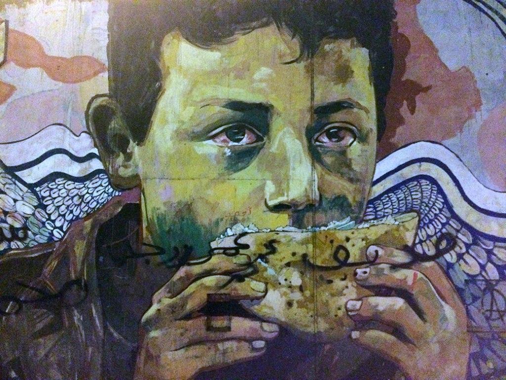 Graffiti from the 2011 Egyptian Revolution along Mohamed Mahmoud Street near Tahrir Square.