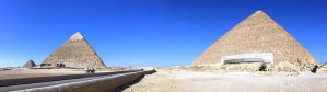 Panoramic view of four of the Giza Pyramids.