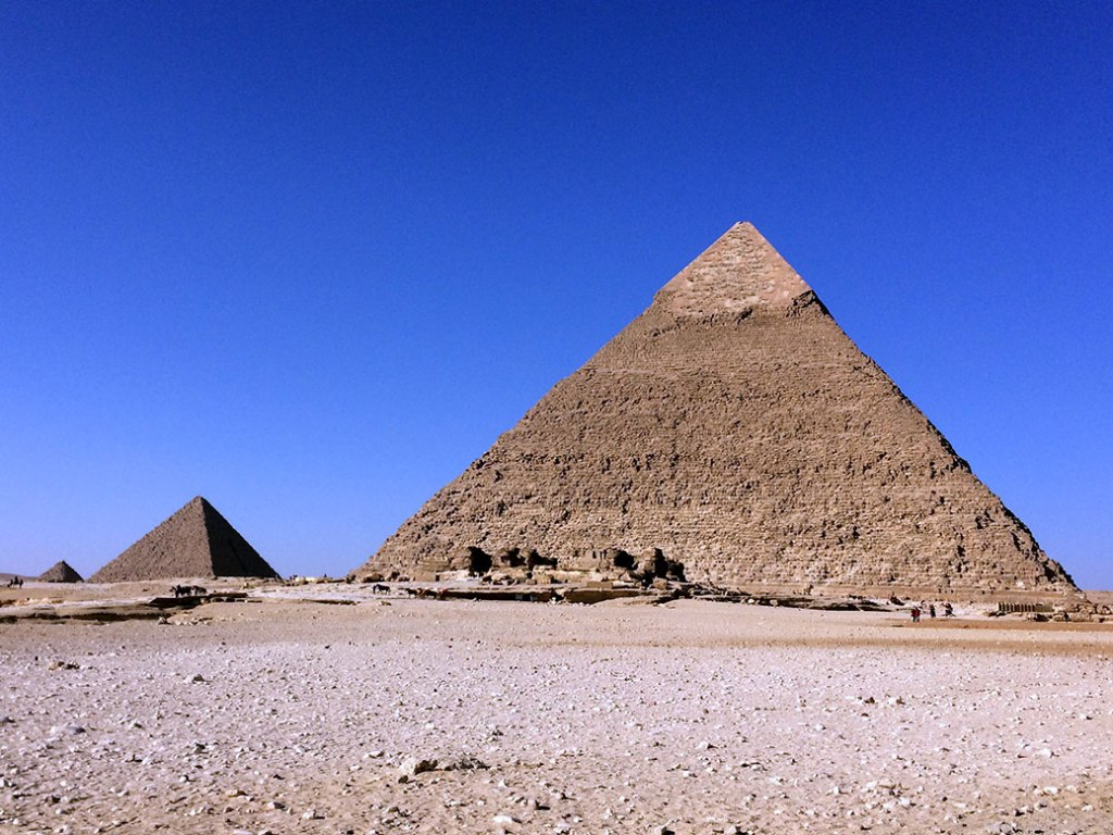 Khafre's Pyramid and Menkaure's Pyramid. In the distance, a smaller pyramid belonging to one of Khufu's wives can be seen.