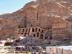 The Urn Tomb at Petra. At the base of the mountain, the B'doul tribe sells wares including stones from temples.