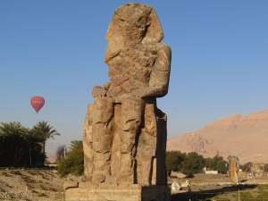 One of the twin statues of Pharaoh Amenhotep III known as the Colossi of Memnon in Luxor.