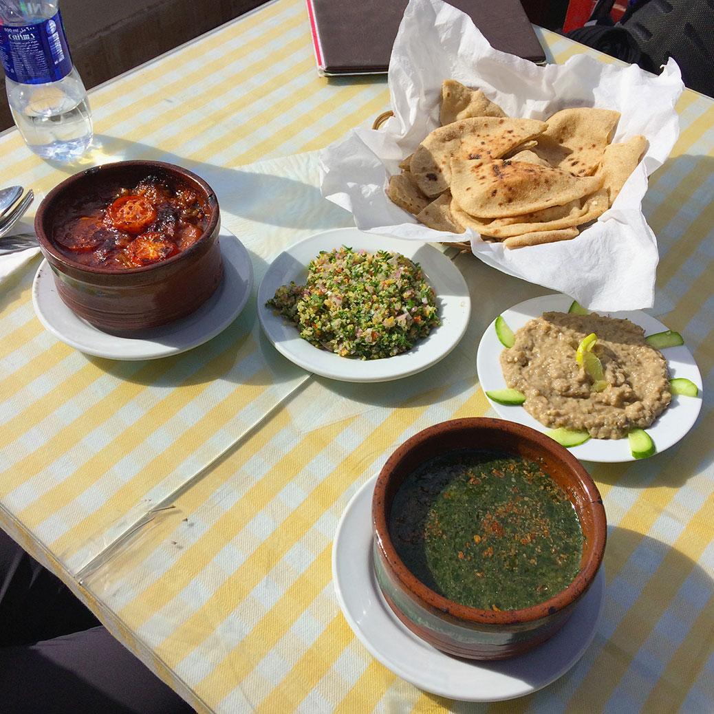 Potato and okra tagine, tabbouleh, baladi bread, baba ganoush and molokhia at Abu Gad.