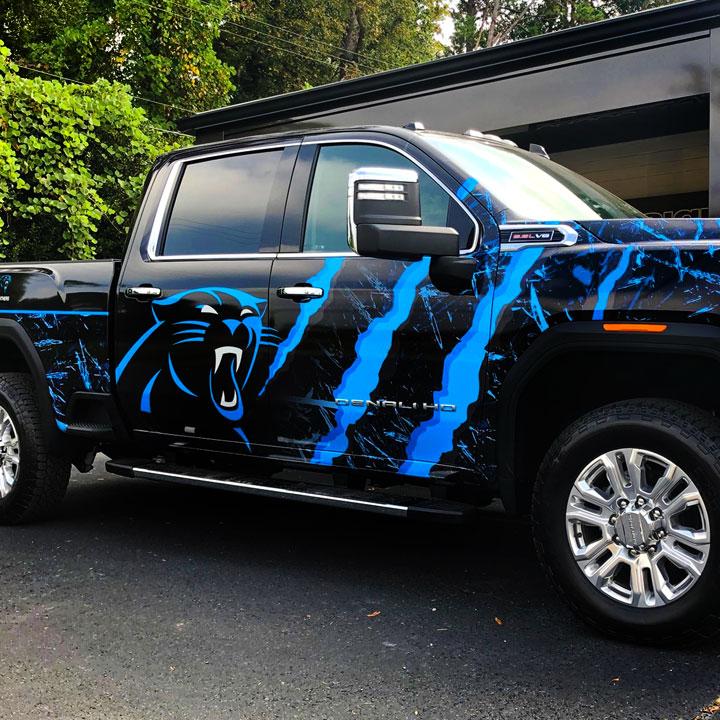 GMC Pickup truck with a Carolina Panthers graphic wrap