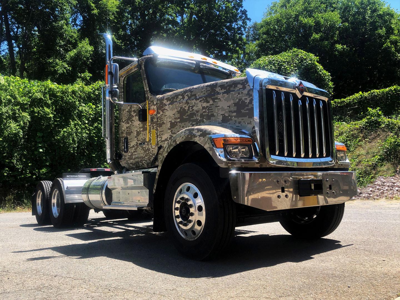 Semi truck with digital camo wrap.