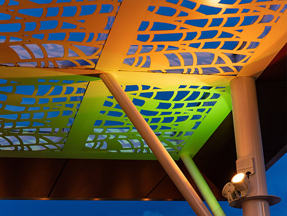 Canopy metalwork illuminated by colorful LED lights
