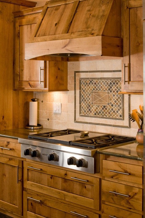 stove vent hood. this custom hood blends in with the rest of cabinetry, allowing woodwork to take spotlight. what type range vent did you choose for your stove