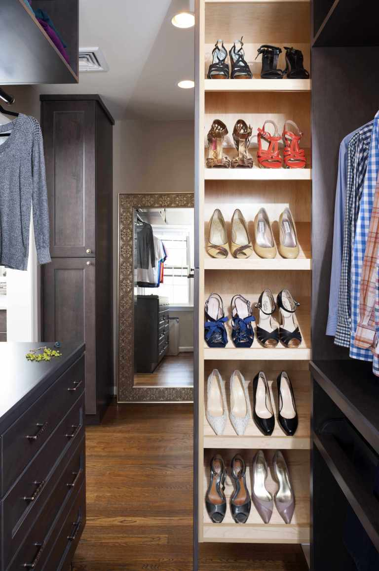 master bedroom walk in closet lots of storage built in shoe rack