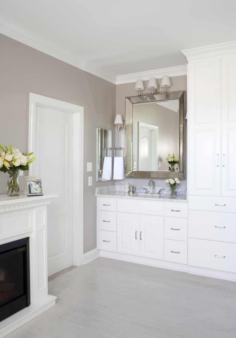 renovated bathroom traditional style neutral color palette lots of storage fireplace